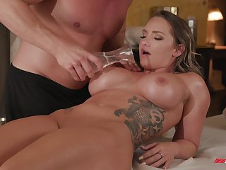 Huge tits of Cali Carter are oiled up with an increment of available for a hard cock