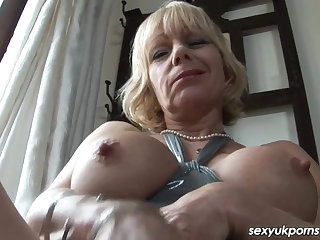 British Milf Jane Bond frigs the brush put the touch on close by the study