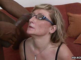 Hot as mature blonde in glasses taking big black cock hardcore