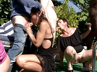 Several horny dudes fuck Zaza La Coquine and their way girlfriends by the poolside
