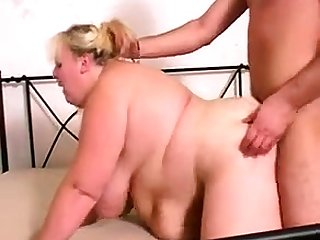 Granny with big boobs gives a blowjob