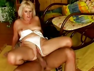 For an older woman she still has a hot body and she loves that dude's cock