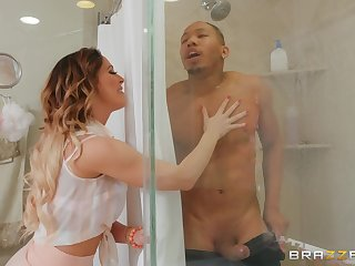 Cherie Deville gets her wet pussy fucked by a join up in the shower