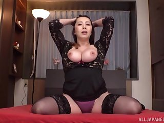 Kazama Yumi shows hermassive tits and unshaved pussy to the camera
