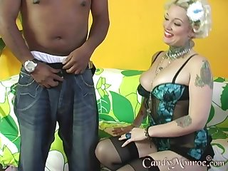 Tattooed blonde moans in pleasure while zooid banged at the end of one's tether a BBC