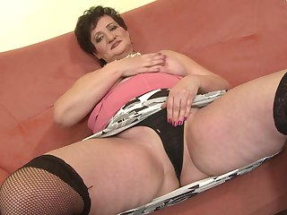 Unskilful mature pitch-dark BBW Josina strips and fingers herself