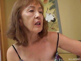 Asian milf Asano Taeko masturbates using their way dildo and a dirty be wary