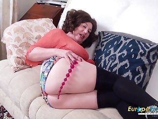 Old single woman Trisha is masturbating with different sexual intercourse toys