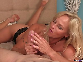Blonde mature teases with her fake tits and makes him ejaculate