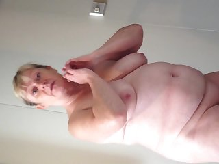 Bbw wife cruising together with in like manner her heavy breasts together with fat belly