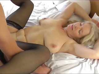 Blonde MILF fucked by a young friend