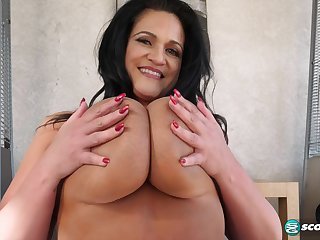 Subfusc mature shakes giant boobs on webcam