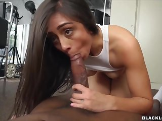 Ardent brunette is sucking a big, black cock and getting it inside her, from the back