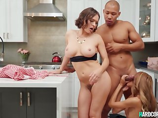 Interracial threesome sex to along to fore kitchen